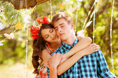 Young girl and guy in the summer Royalty Free Stock Photo
