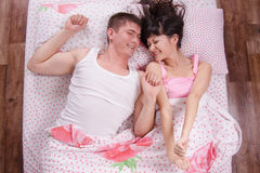 Young girl and guy woke up in bed sipped Stock Image