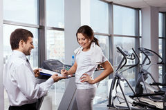 The young girl in gym stock photo