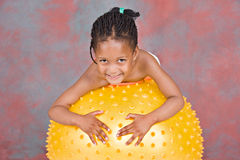 Young girl on gym ball Stock Image