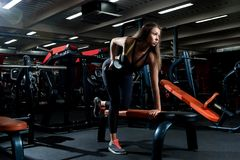 Young girl in a gym doing sports royalty free stock photos
