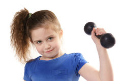 Girl lifting dumbbells Royalty Free Stock Photography