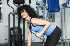 Young girl in the gym for sports Stock Image