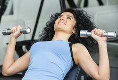 Young girl in the gym for sports Stock Images