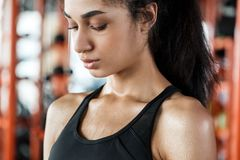 Young woman in gym sporty lifestyle standing close-up sweating breathing tough training stock images