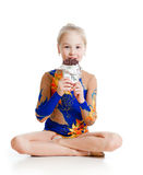 Young girl  gymnast  eating chocolate while break Royalty Free Stock Images