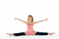 Young Girl In Gymnastic Pose Doing Splits Royalty Free Stock Photography