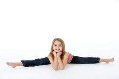 Young Girl In Gymnastic Pose Doing Splits Royalty Free Stock Images