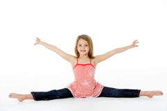 Young Girl In Gymnastic Pose Doing Splits Stock Photography