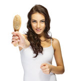 Young girl with hair brush Stock Image