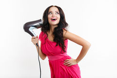 Young girl with hairdryer Stock Photo