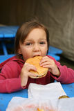 Young girl with hamburger Royalty Free Stock Image