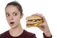 Young Girl with a hamburger Royalty Free Stock Photography