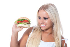 Young girl with a Hamburger Stock Photography