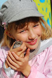 Young girl  with hamster outdoor Royalty Free Stock Photo