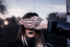 Young Girl and hand coverign her face. Royalty Free Stock Photography