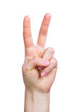Young girl hand victory sign. On a white background isolated Royalty Free Stock Photography
