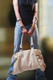 Young girl with handbag Stock Photos