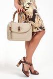 Young girl with handbag. Young girl comes with a fashionable handbag Royalty Free Stock Photos