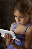 Young Girl with Handheld Game Stock Images