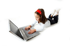 Young girl handling a laptop Royalty Free Stock Photography