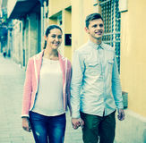 Young girl and handsome man having a walk together Royalty Free Stock Photos