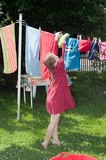 Young girl hanging cloth to dry Stock Photo