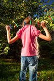 Young girl hanging on clothesline at garden Stock Photo