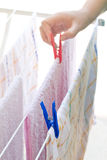 Young girl hanging cloths on clothesline Royalty Free Stock Image