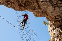 Via Ferrata - Girl Hanging on the Metal Net Royalty Free Stock Images