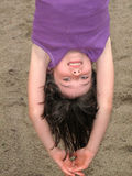 Young girl hanging upside down stock photography
