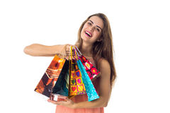 Young girl happily keeps packages in hands isolated on white background Stock Photos