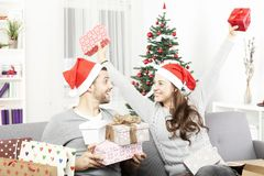 Young girl is happy about the christmas gifts Stock Photography