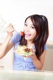 Young Girl Happy Eat salad at home Royalty Free Stock Image