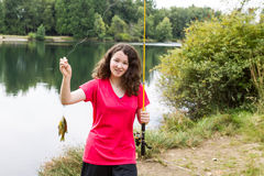 Young Girl Happy with her Catch at the Lake Stock Image