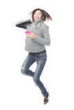 Young Girl happy jump and listen music Royalty Free Stock Photos