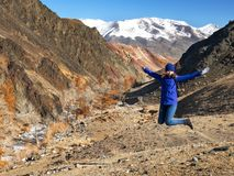 The young girl happy jump in mountains with exciting view. royalty free stock photography