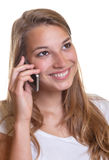Young girl is happy on the phone Stock Photography
