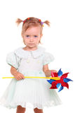 Young girl happy with wind toy Stock Photos