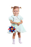Young girl happy with wind toy Stock Image