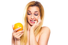 A young girl has been reluctant to eating oranges. Stock Photography