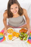 Young girl has breakfast top view Stock Image