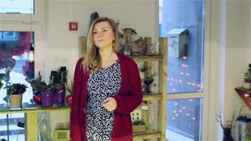The young girl has come to the store to buy flowers. stock video footage
