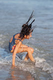 Young girl has fun at the seafront Royalty Free Stock Photography