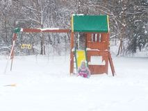 Snow fun at playset royalty free stock photo