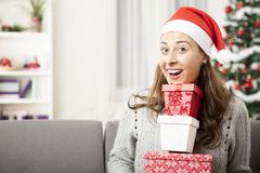 Young girl has a lot of presents for you Royalty Free Stock Photography
