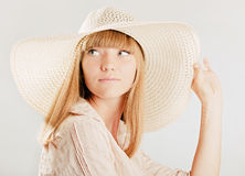 Young girl in a hat Stock Photos