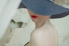 Young girl in hat with bare Breasts.  Stock Images