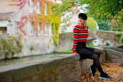 Young girl in hat at bridge in Bruges stock photography