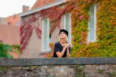 Young girl in hat at bridge in Bruges. Belgium. Autumn season Stock Photo